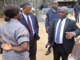 Min. Cherue chitchats with prison superintendent on tour at Monrovia Central Prison.