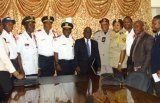 Cllr. Cherue (Middle in suit) as chairperson of Joint Security poses with some heads of national security agencies.